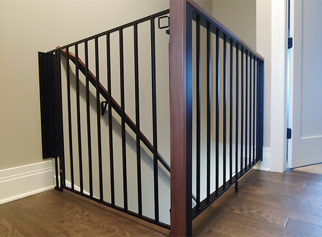 EW&F fabricated and installed a baby gate to secure the stair landing of this home, using metal welding and woodworking