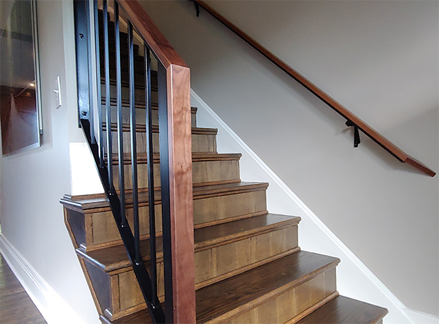 A custom fabricated wood and metal stair railing created by EW&F for this Colton home