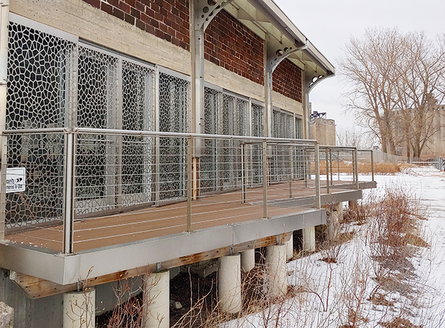 A extensive metal cable railing was fabricated and installed at the Rigidized Metals headquarters by Erie Welding & Fabrication